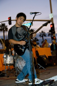 Adam Ho performing on a recent Surf City Night. Photo by Mark Diminalanta